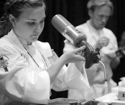 "Pantry Chef Delanie Gastineau prepares bruléed figs at the ""Culinary Clash: Battle Los Angeles"""