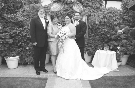 The Five Crowns' English garden, a favorite spot for wed-dings and private parties, has been redesigned and replanted. Rachelle and Sam Heminger were married there this summer. Thirty years ago, Rachelle's parents, pictured with the newly-weds, were also married in our garden.